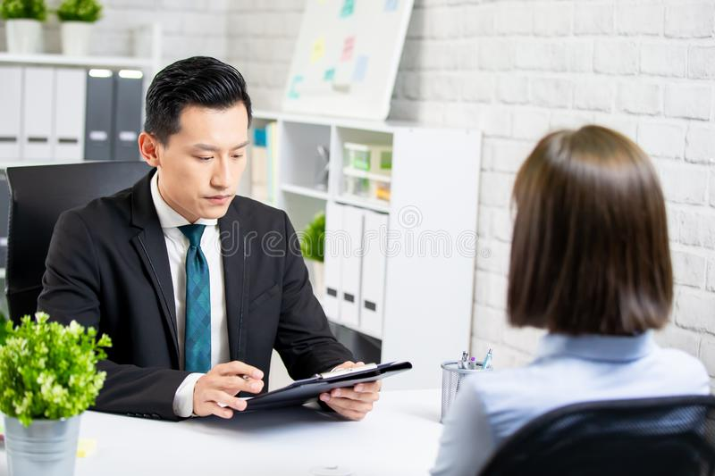 Male boss interview a woman. Asian male boss interview a women at the office royalty free stock photos