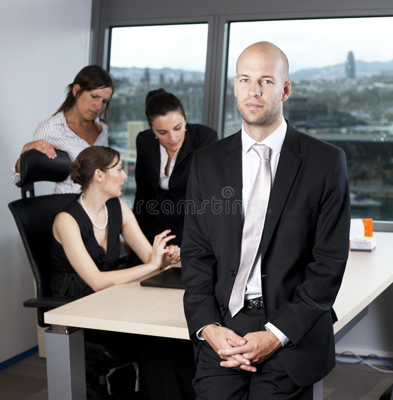 Download Male Boss Standing In Front Of His Collegues Stock Photo - Image of colleagues, career: 22996544