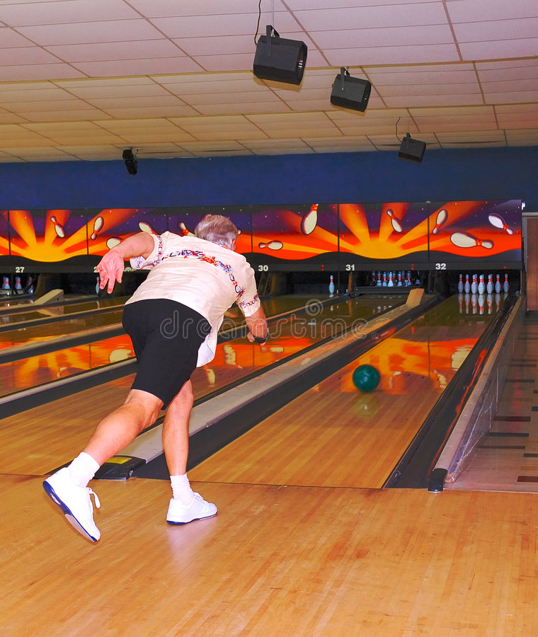 Male Bowler In Action Royalty Free Stock Images