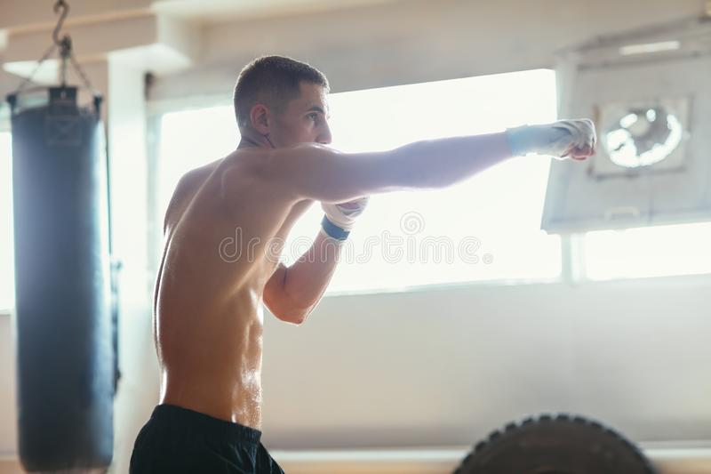 Male boxer during boxing exercise making direct hit royalty free stock photography