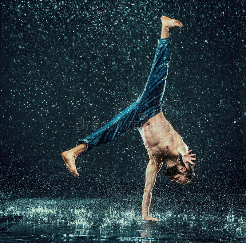 The male break dancer in water. stock image