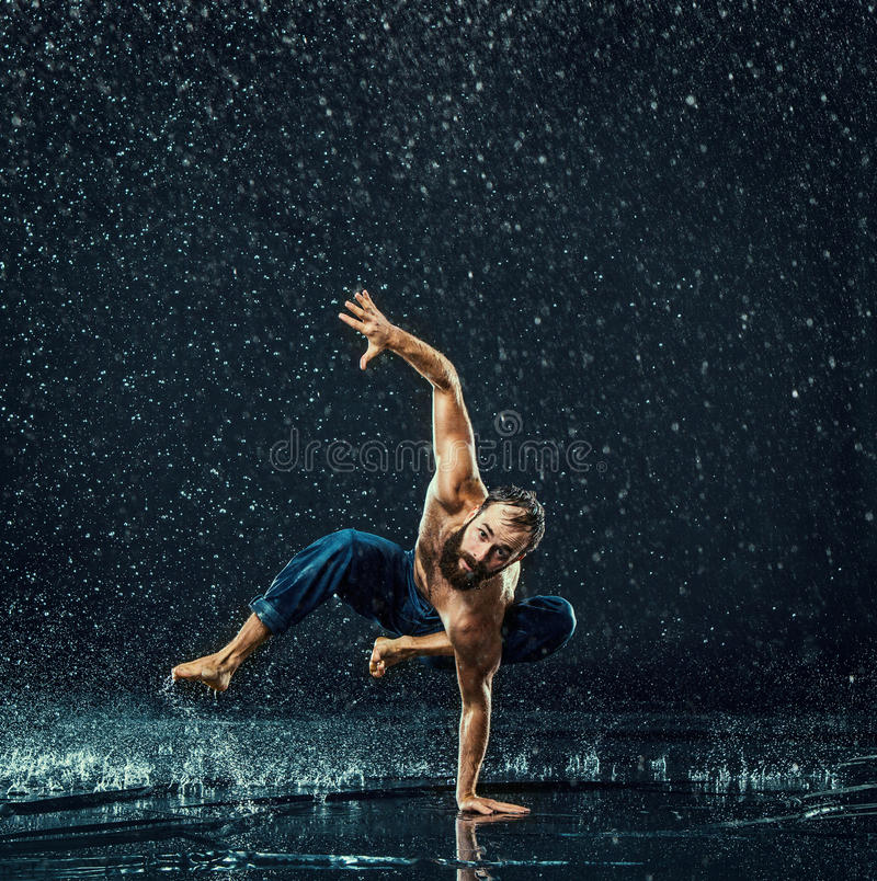The male break dancer in water. royalty free stock photo