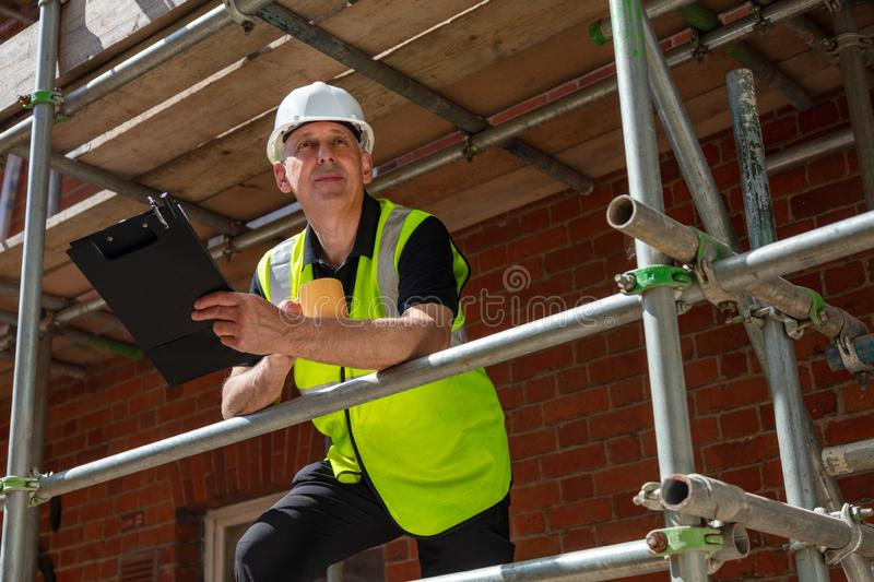 Construction Foreman Builder Architect on Building Site With Clipboard stock image