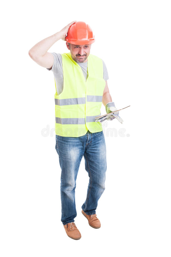 Male builder with tablet looking confused or doubtful royalty free stock photo