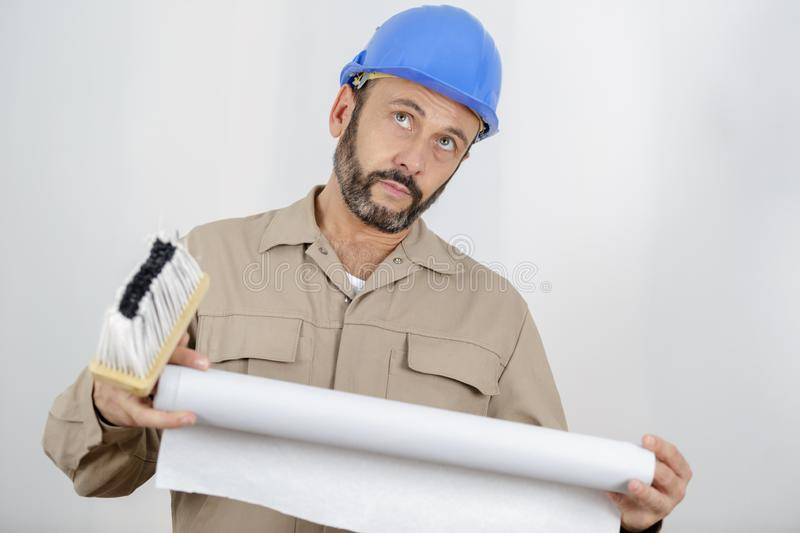 Male builder thinking about something. Man royalty free stock images