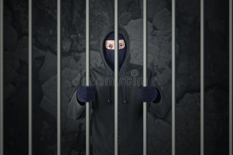 Male burglar in prison royalty free stock photos