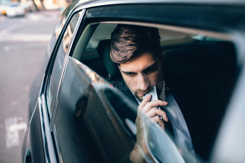 Male business executive travelling by a cab royalty free stock images