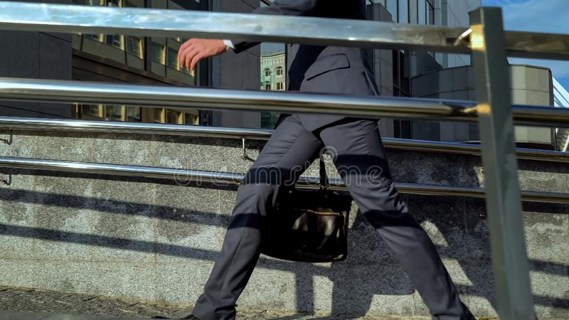 Male in business suit approaching office center, going to working place, career. Stock photo stock image