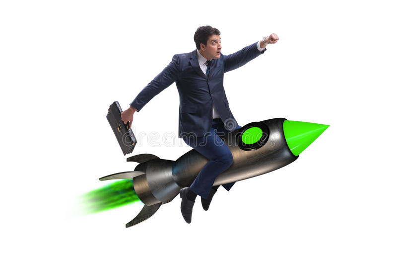 The male businessman flying on rocket in business concept stock image