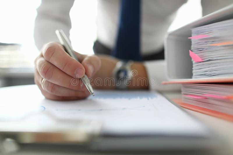 Male businessman hold silver pen in hand royalty free stock photos