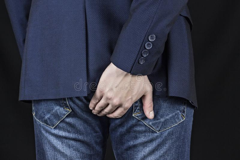 Male businessman holding his ass, hemorrhoids royalty free stock photo