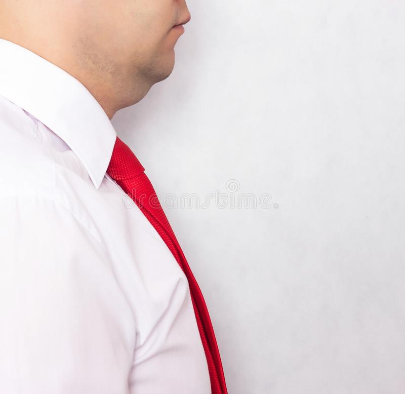 Male businessman in white shirt and double chin tie on a white background, obesity, close-up, copy space stock photos