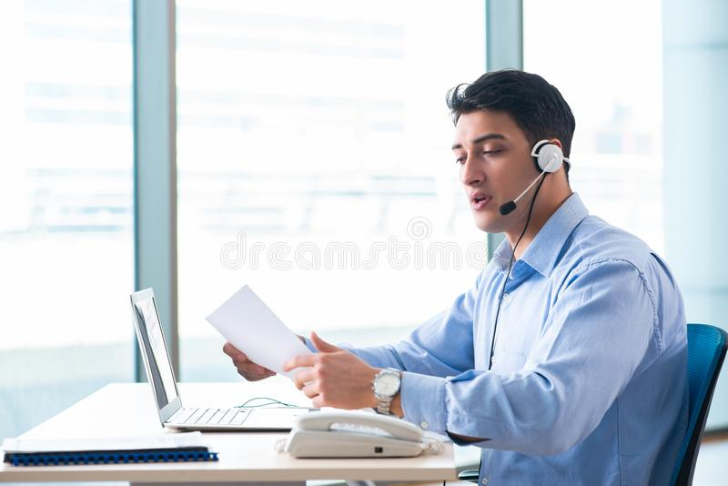 Male call-center operator in business concept royalty free stock image