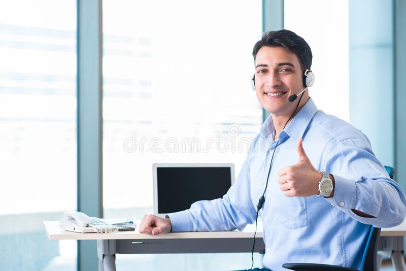 Male call-center operator in business concept. The male call-center operator in business concept royalty free stock photos