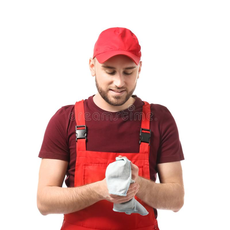 Male car mechanic wiping hands on white background royalty free stock image