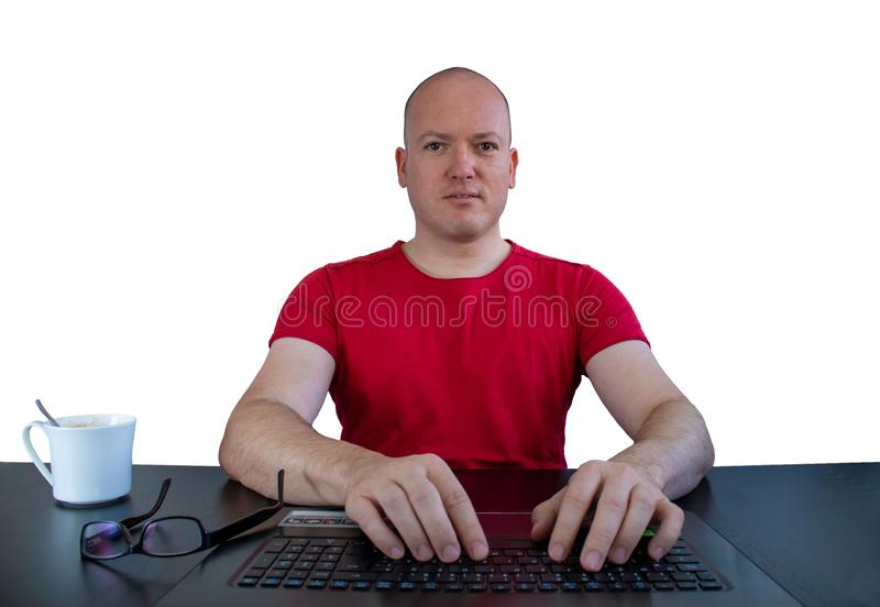 A male caucasian person at the notebook looking to the webcam royalty free stock photography