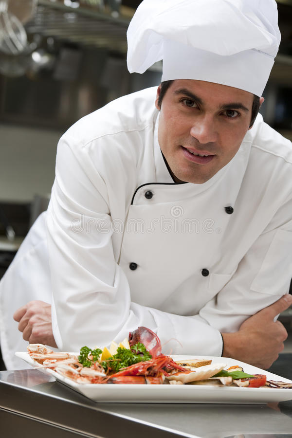 Male Chef In The Restaurant Stock Photo