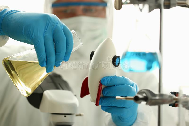 Male chemist hold white rocket in hand royalty free stock images