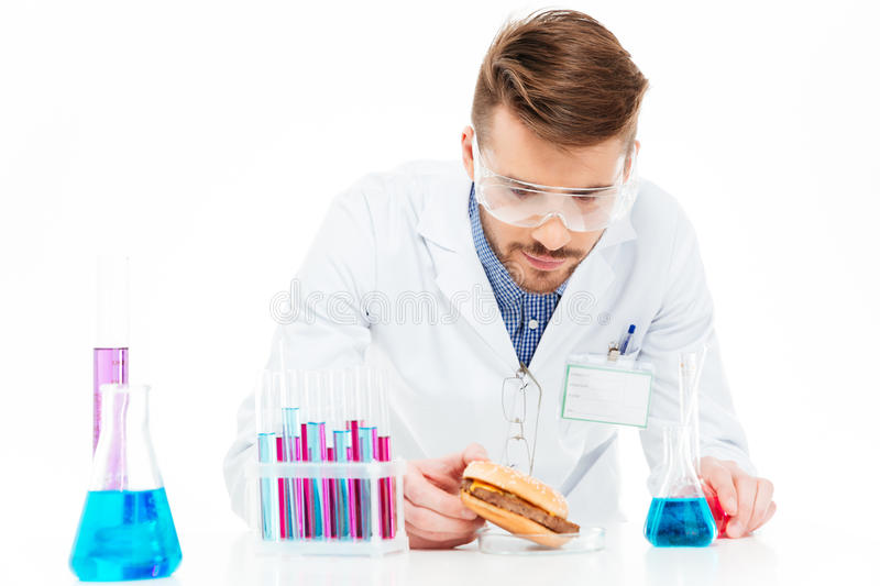 Male chemist making GMOs food stock photography