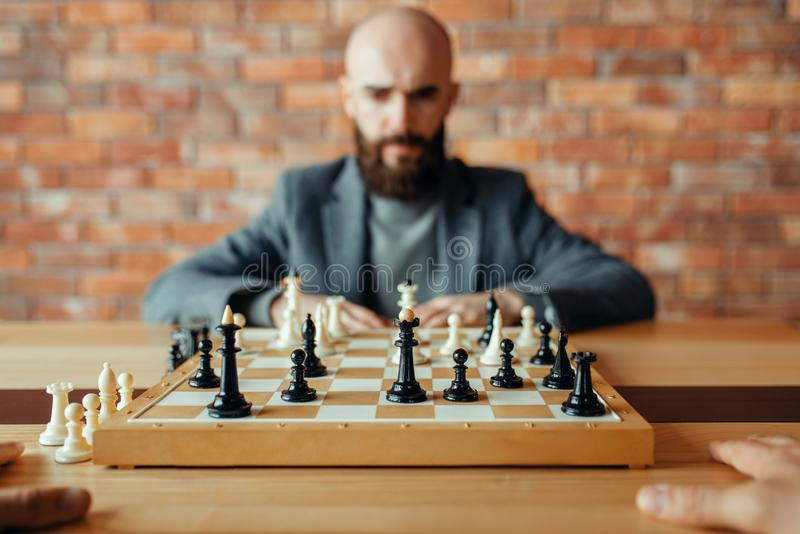 Male chess player, thinking process royalty free stock photography