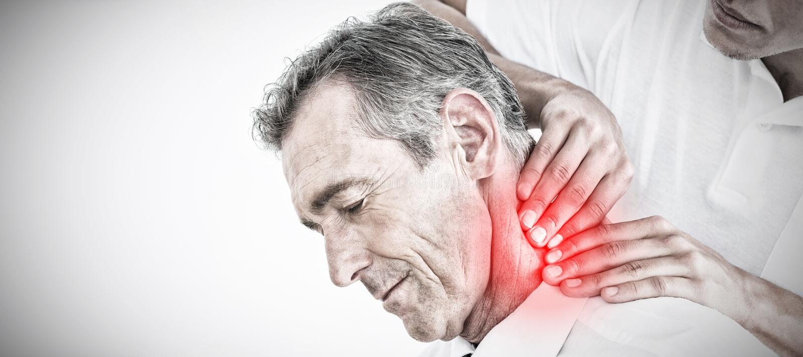 Composite image of male chiropractor massaging patients neck. Male chiropractor massaging patients neck against highlighted pain royalty free stock image