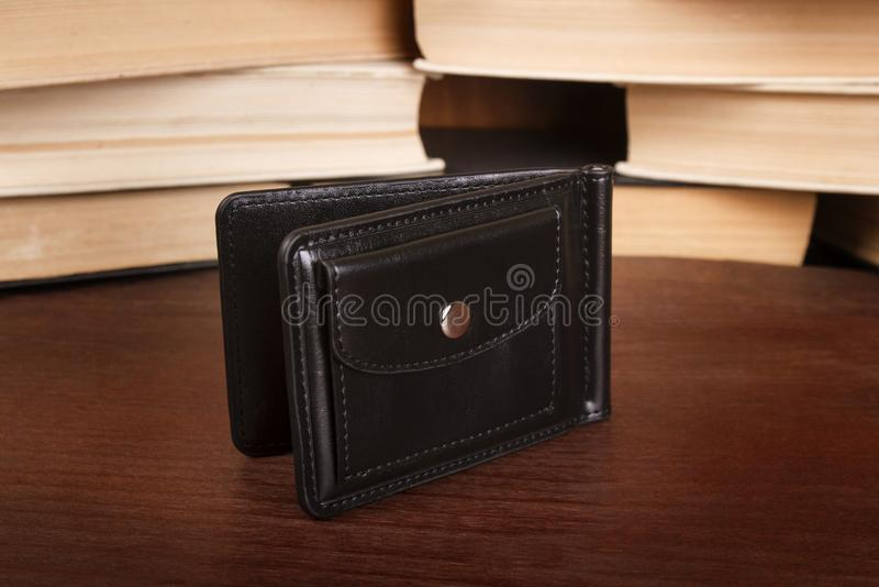 Male clamp for money. Closed leather wallet royalty free stock images