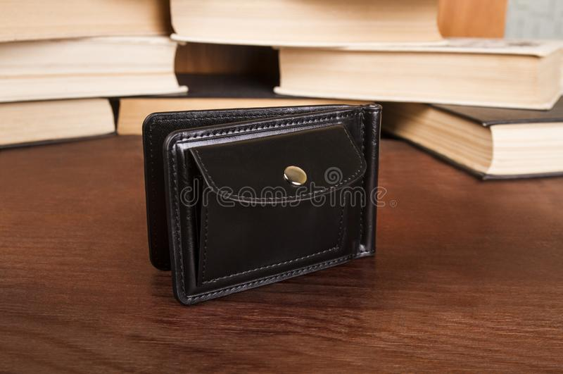 Male clamp for money. Closed leather wallet stock photography