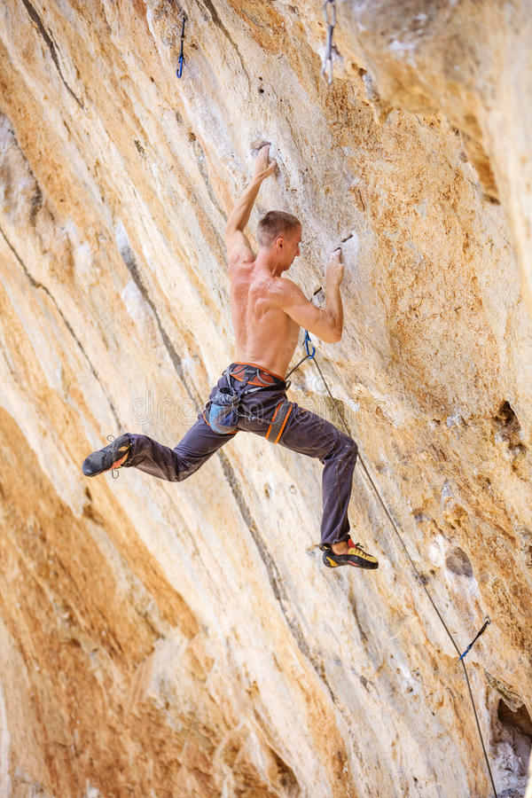 Male climber jumping on handholds stock photos