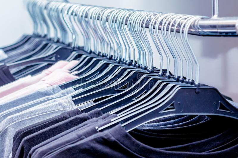 Male clothing on hanger at the modern shop boutique_ royalty free stock photos