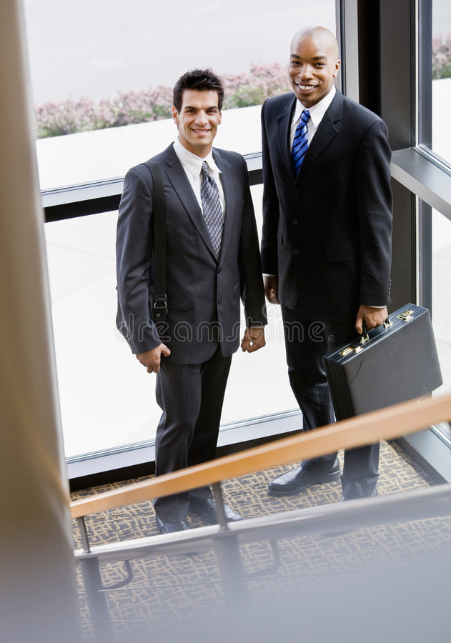 Download Male Co-workers Posing Together In Corner Stock Photo - Image: 6604572