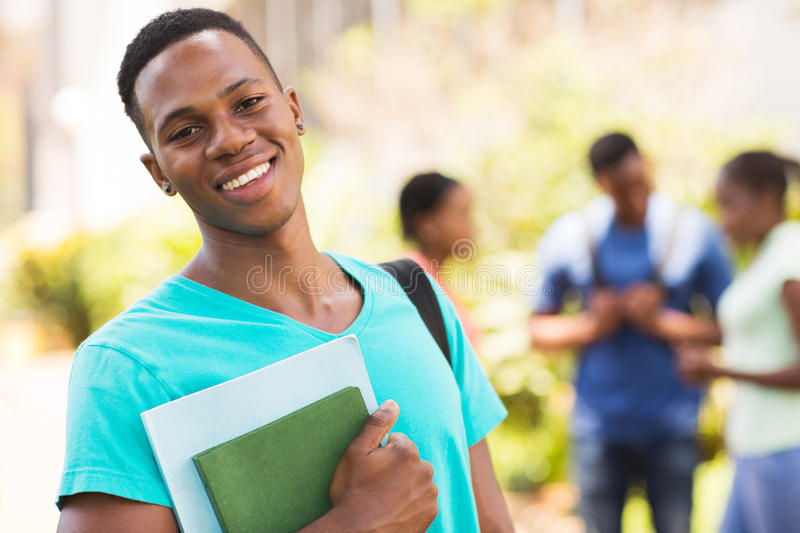 Male college student. Smiling young african male college student royalty free stock photos