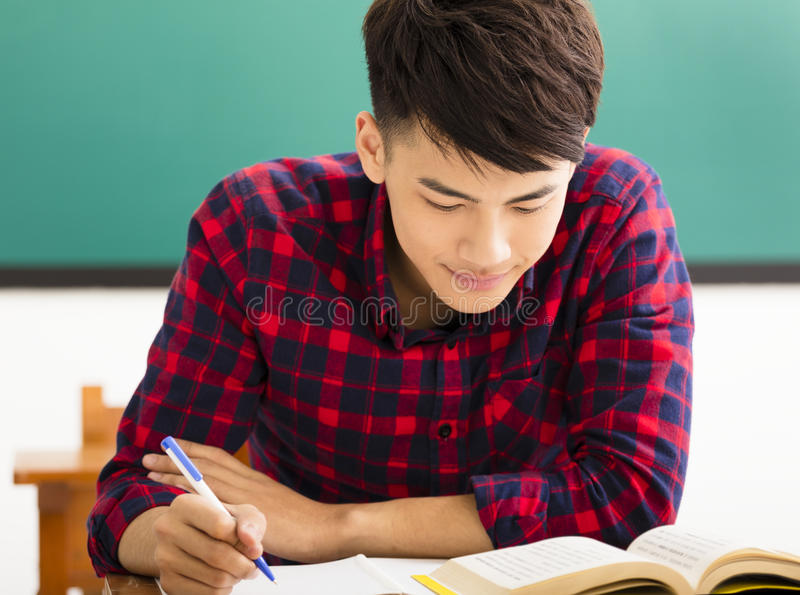 Male college student study in university classroom royalty free stock photo