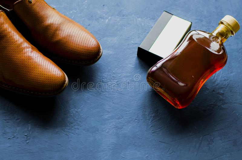 Male Cologne. Male Cologne on a black background. Bottele brandy royalty free stock image