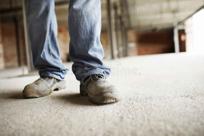 Male Construction Worker Legs stock photo