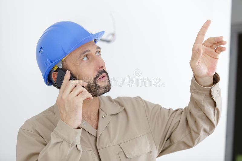 Male construction worker using mobile phone stock photography