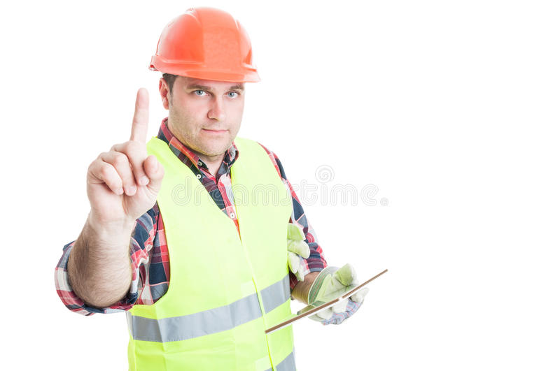 Male constructor with tablet doing a waiting gesture stock images