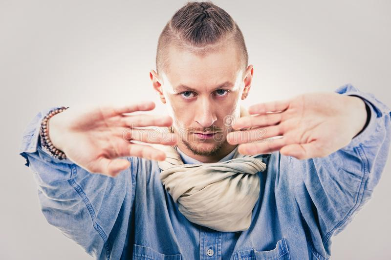 Male contemporary hip hop dancer in denim. Caucasian male dancer wearing blue denim shirt and pants on light background performing hip hop and contemporary style stock photos