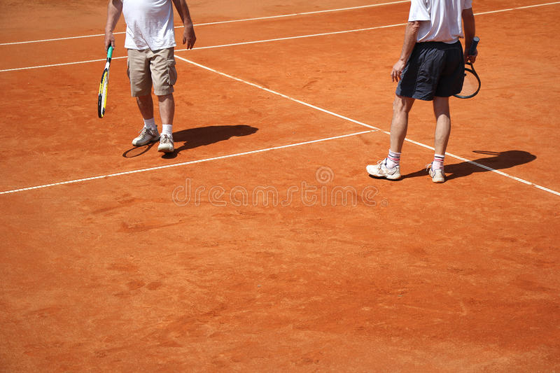 Male couple playing tennis stock image