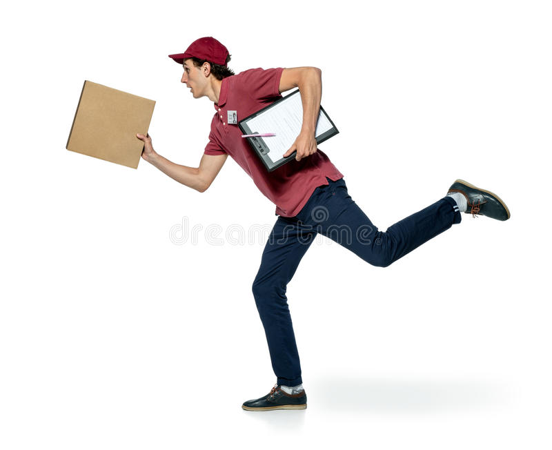 Male courier company worker delivering a package. stock photography