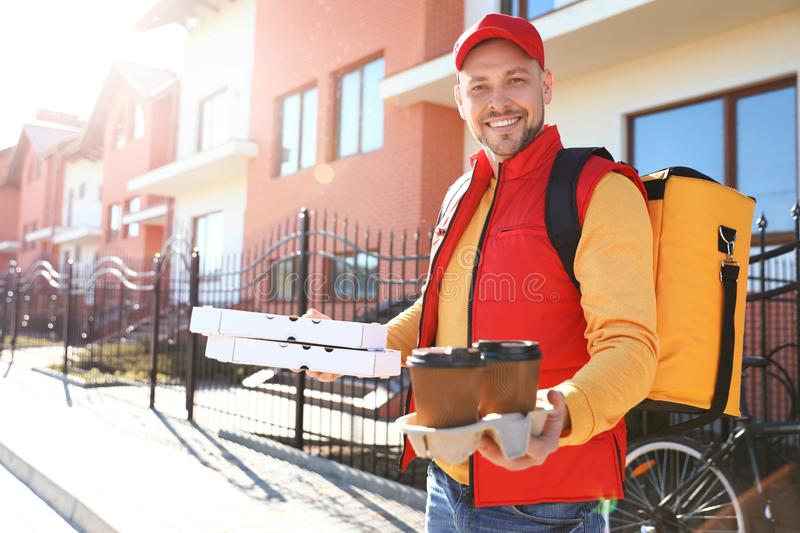 Male courier delivering food in city stock photos