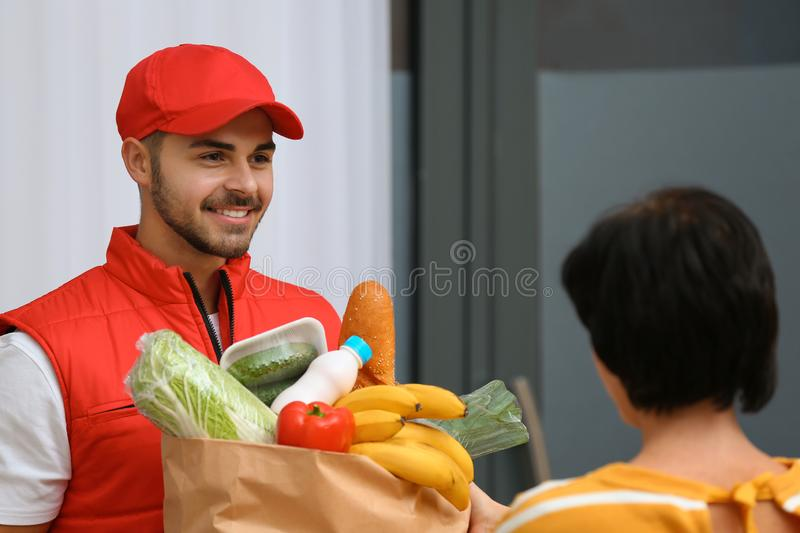 Male courier delivering food to client stock photography