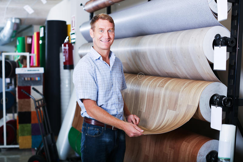 Male customer choosing linoleum flooring stock photos