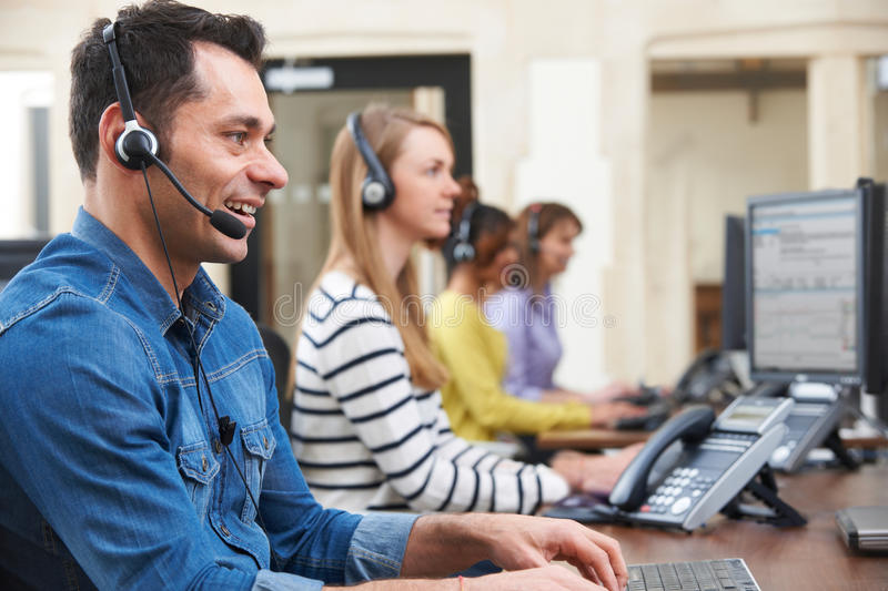 Male Customer Services Agent In Call Centre. Customer Services Agents In Call Centre royalty free stock images