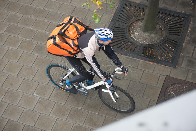 Download Male Cyclist With Backpack On Sidewalk Stock Image - Image: 36284431
