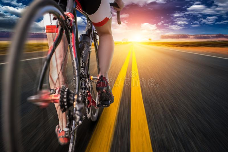 Cyclist on bike path, view from the rear wheel royalty free stock photography