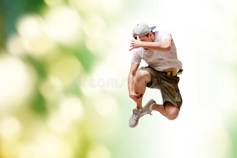 Male dancer jumping in the air. Dance and fitness concept - male dancer jumping in the air royalty free stock photo