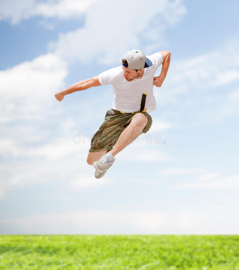 Male dancer jumping in the air. Dance and fitness concept - male dancer jumping in the air stock photos