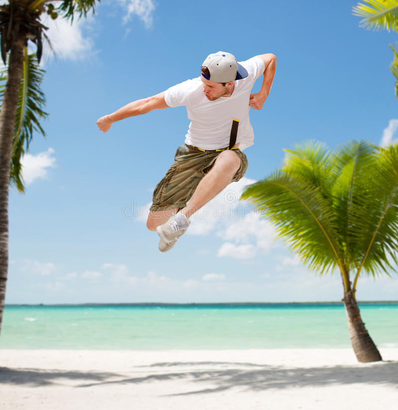 Male dancer jumping in the air. Dance, summer and holidays concept - male dancer jumping in the air stock images
