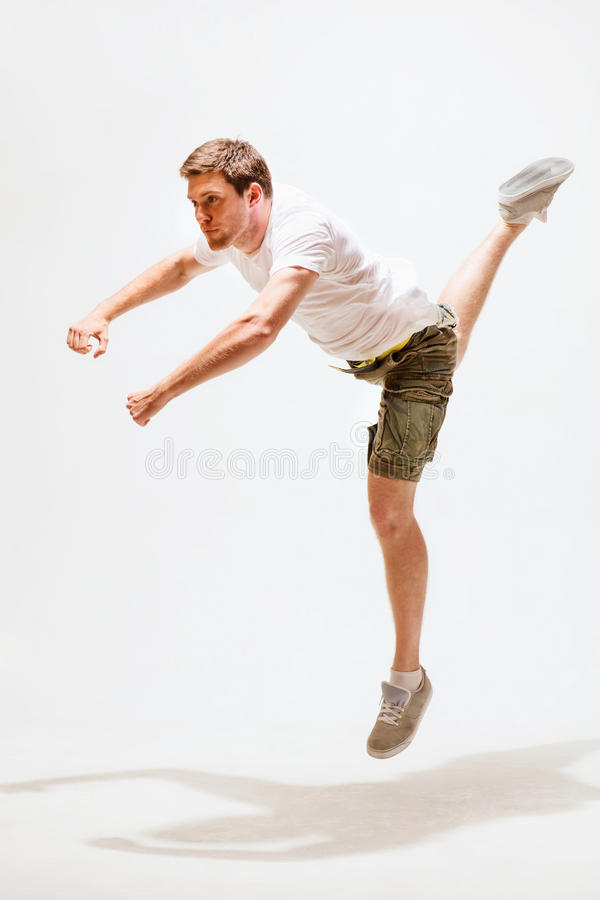 Male dancer jumping in the air. Sport and dancing concept - male dancer jumping in the air royalty free stock photos