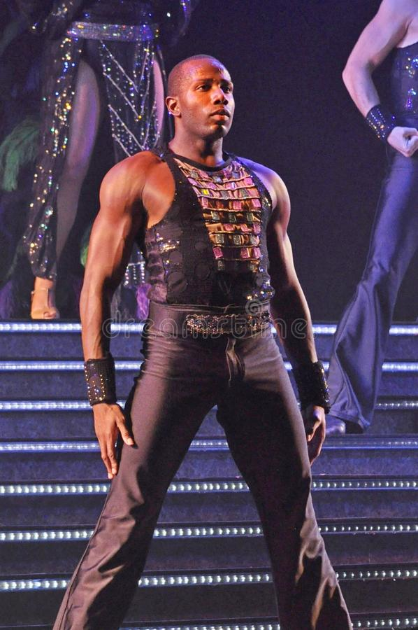 Male dancer in a show. Singers and dancers in production show onboard cruise ship Adventure of the Seas stock photography